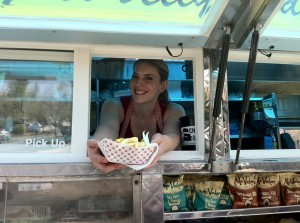 Jessie handing out a great sandwich at GourMelt.